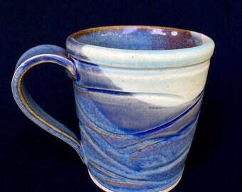 Large coffee mug in blues with a swirled design