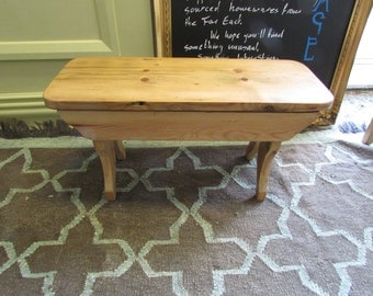A reclaimed timber stool.