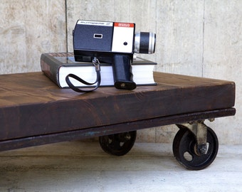 Reclaimed coffee table on vintage pallet and casters.