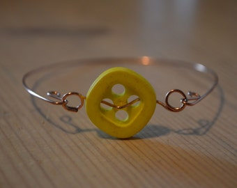 bracelet with yellow button vintage