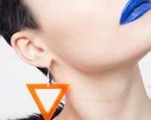 Lucite neon orange earrings, minimal perspex chandelier.