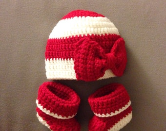 Red and white baby booties and beanie set