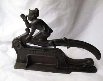 Cast Iron Nose Thumbing Elf Plug Cutter