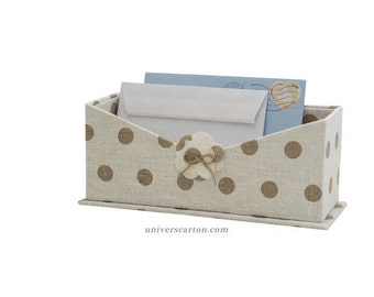 Box mail, cardboard storage mail, office covered with white linen with Brown polka dots fabric accessory