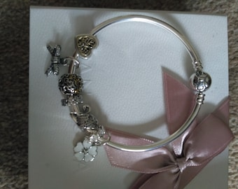 SALE !! Pandora Bangle with charms Worth over 500