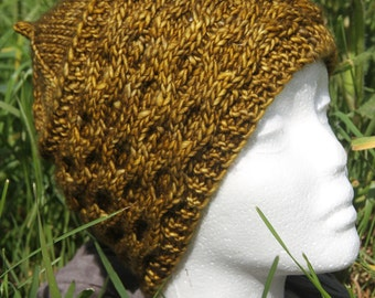 Mustard hat with cables knitted hand