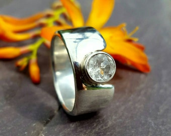 Contemporary 10mm Wide Band Sterling Silver Ring with Tube Set 6mm Facetted White Topaz.