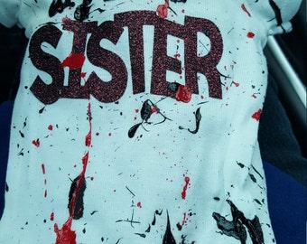 Little brother or sister paint splattered onesie
