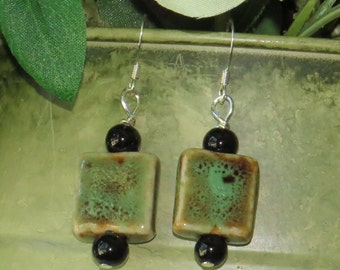 E-1669  Green ceramic bead earrings with black onyx accent