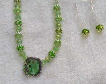 green glass beaded necklace and earrings