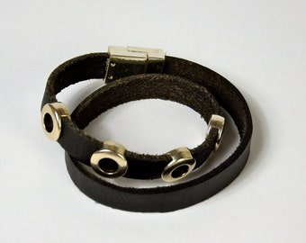 double wrapped black leather bracelet, with 4 round silver beads and a magnetic clasp