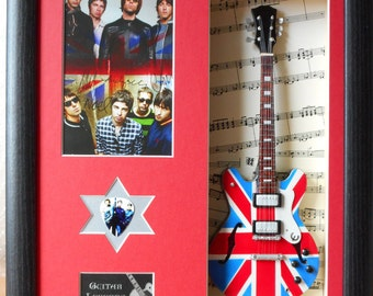 Oasis Noel Gallagher Minature Tribute Framed Guitar & Plectrum Display