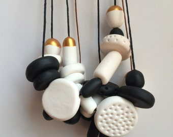 kids white, black and gold polymer clay necklace