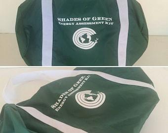 Green vinyl duffel bag. Gym bag. Travel bag.