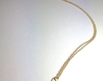 Gold colored layering necklace
