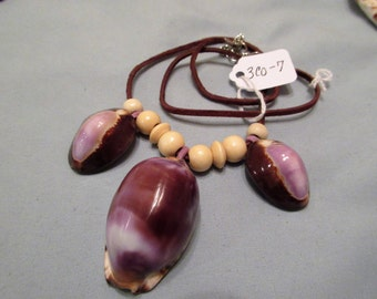 Natural, leather shells, wood beads.