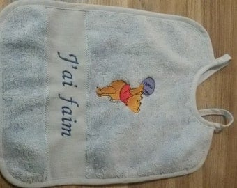 Bib with embroidered motif and name