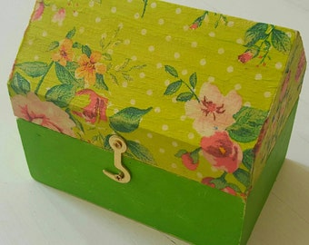 A shabby chic and decopage jewellery box in a house shape. Very colourful