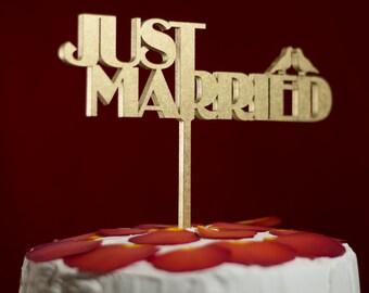 Wedding cake topper. Cake topper just married. Golden cake topper