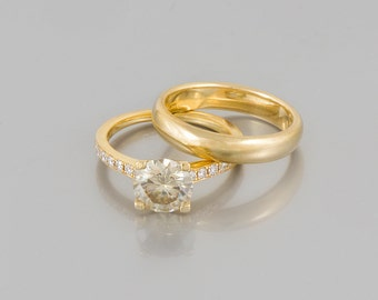 pair of engagement rings beautiful gold and diamond