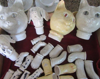 Vintage glazed  ceramic  cats  and Dalmatians  dogs heads and body's  parts to make your own stuff toy's two dogs and three cats parts.