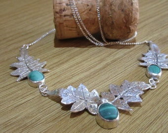 Fine Silver and Malachite jasmine leaf necklace on sterling silver chain.  Hallmarked