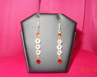 Handmade earrings with swarovski crystals.