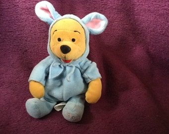 Winnie the Pooh dressed as the Easter Bunny