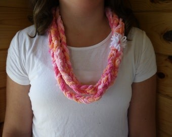 Pink and orange braided scarf with flower
