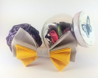 Bow tie brooch pin grey and yellow