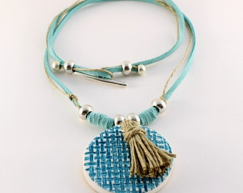 Necklace with textured piece turquoise suede