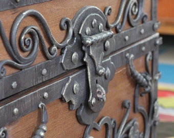Chest forged, wooden, wrought iron elements