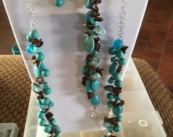 41 turquoise and brown beads with glass bead focal on silver wire