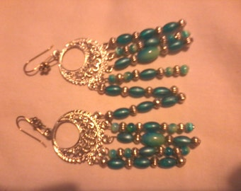 Green and gold earrings.