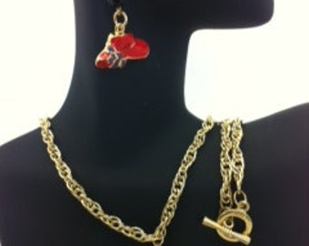 gold necklace and earrings with red hats