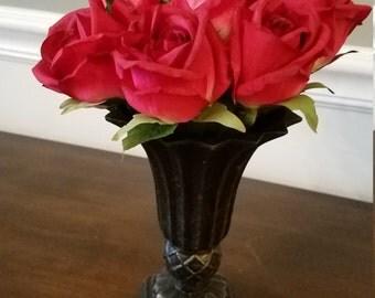 Red roses in vintage vase
