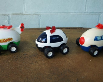 Vintage Egg Shaped Pull Back Toys – Helicopter, Cop Car, and Airplane