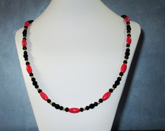 Coral, black and gold long necklace