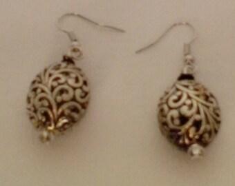 Silvertone filigree oval earrings