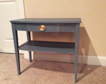 Hand painted table with small draw.  Original hardware.