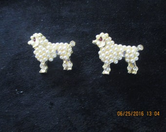 pair of poodle brooches