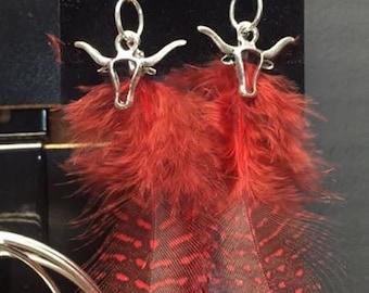 Red steer feather dangle earrings