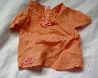 Used OG doll orange top