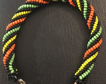 Spiral Bracelet in black, green, and yellow