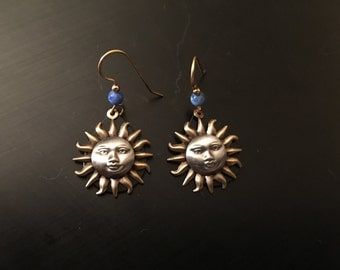 Gold toned sun earrings