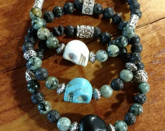 Beautiful trio of Volcanic rock, African Turquoise, and Turquoise Skull beaded bracelets.