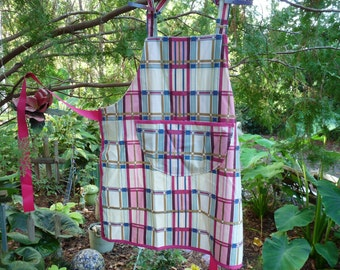 Apron cream/pink/blue with gold stripe.  Holidays or everday