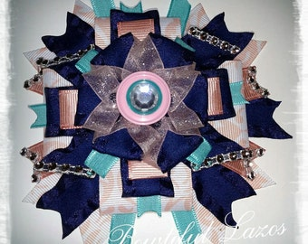 Navy blue, peach, and turquoise pinwheel hair bow