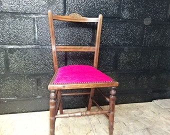 A Mahogany Decorative Chair with Pink upholstery