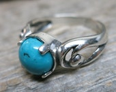 Eidyia ring ... cast sterling silver / spiral scrolls / sleeping beauty turquoise / US ring size 8